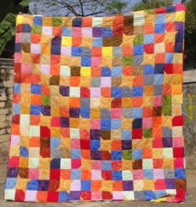 Yellow Star Scrappy Batik Quilt 1