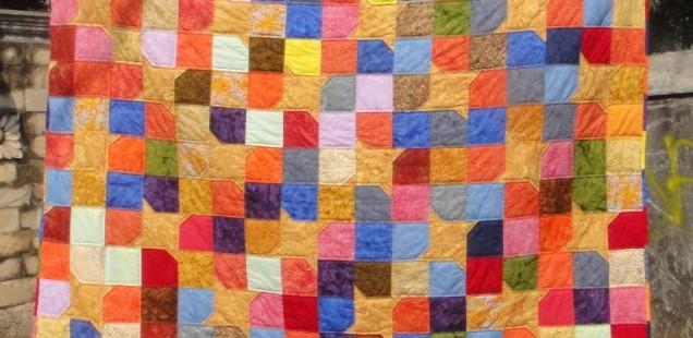 Yellow Star Scrappy Batik Quilt